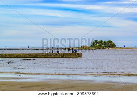 People Fishing At Breakwater, Montevideo, Uruguay