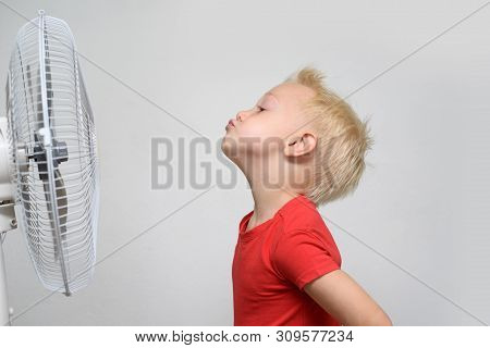 Pretty Smiling Blond Boy In Red Shirt And Closed Eyes Enjoying The Cool Air. Summer Concept