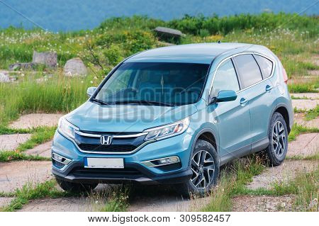 Mnt. Runa, Ukraine - Jun 22, 2019: Honda Crv On A Paved Platform In Mountains. 4 Generation Of A Pop