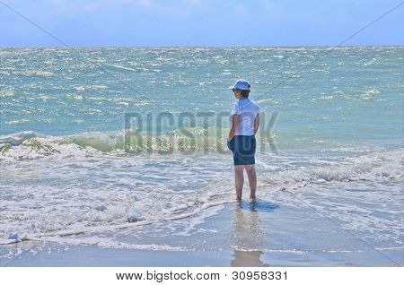 Woman Wading In Surf