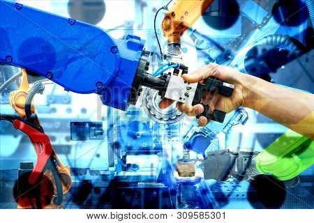 Handshake Of Robotic And Human Join For Teamwork On Smart Factory With Double Exposure Image Of Indu