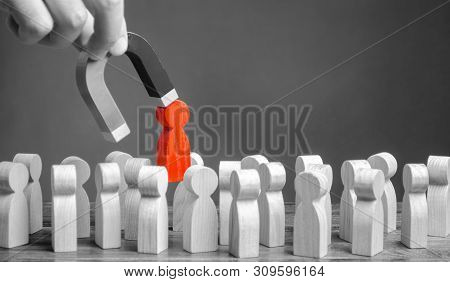 Businessman Pulls A Red Figure Out From The Gray Crowd With A Magnet. Increase Team Efficiency, Prod