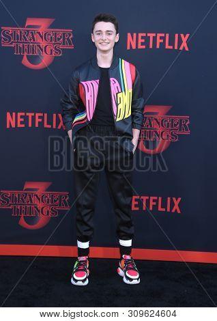 LOS ANGELES - JUN 28:  Noah Schnapp arrives for the Netflix 'Stranger Things' Season 3 Premiere on June 28, 2019 in Santa Monica, CA