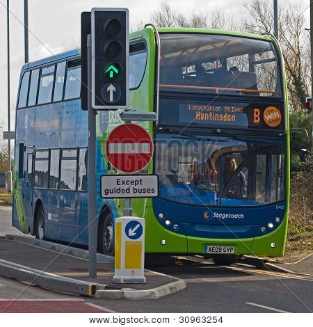 Guided Bus Entering Town - EDITORIAL USE