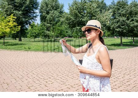 Beautiful Young Positive And Independent French Hipster Tourist Girl With Hat And Sunglasses Adventu