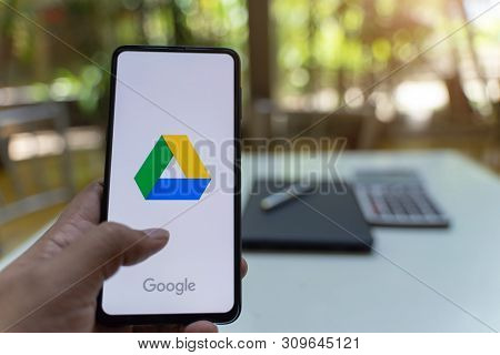Chiang Mai, Thailand - May.26,2019: Man Hands Holding Xiaomi Mi Mix 3 With Google Drive Apps On Scre