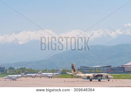 Almaty, Kazakhstan - May 10, 2019: View From The Airfield Of Almaty On The Zaili Alatau, A Mountain