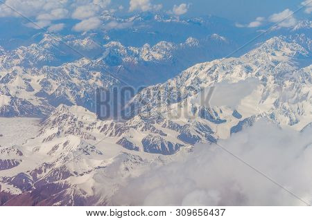 View From The Illuminator Of The Plane To Zailiyskiy Alatau, A Mountain Range In The Northwest Of Ti