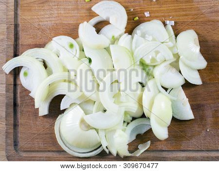 Cut Onion On Cutting Board