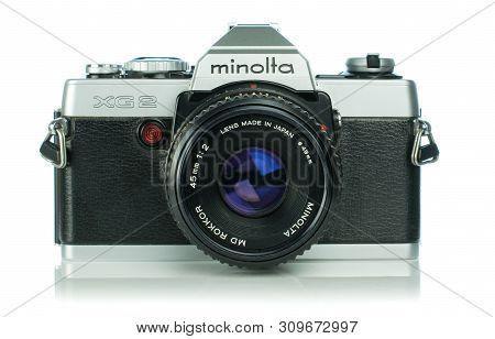 Niedersachsen, Germany April 9, 2019: A Minolta Xg2 35mm Analog Film Camera On A White Background