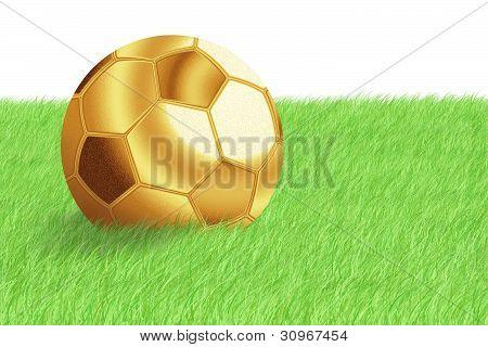 Golden Football Ball On Green Grass