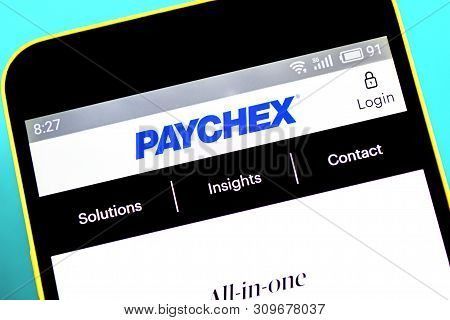 Berdyansk, Ukraine - April 10, 2019: Paychex Website Homepage. Paychex Logo Visible On The Phone Scr