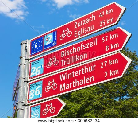 Laufen-uhwiesen, Switzerland - June 7, 2019: A Directional Sign Showing Directions And Distances To
