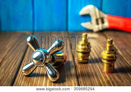 Plumbing Supplies And Tools On A Blue Wooden And Vintage Background.