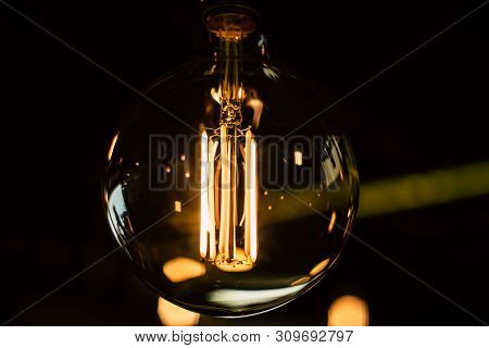 Vintage Light Bulb Closeup With Dark Background