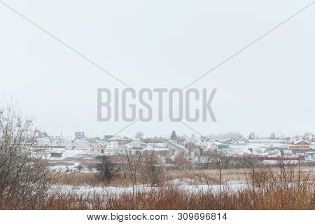 Winter Landscape Of A Deserted Snow Field And Leaden Sky