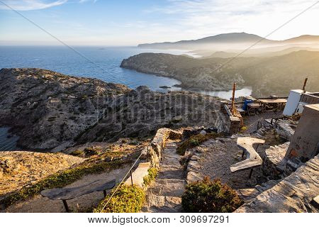 Sunset Over Sea Cliffs And Low Clouds With Clear Sky View From Cap De Creus, Catalonia (spain)