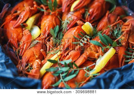 Close-up Of Boiled Crawfish With Lemon And Green