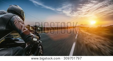 Motorbike On The Road Riding. Having Fun Driving The Empty Highway On A Motorcycle Tour Journey