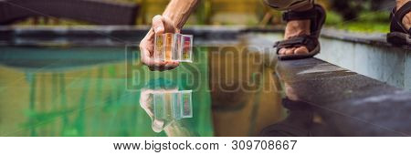 Pool Worker Checks The Pool For Safety. Measurement Of Chlorine And Ph Of A Pool Banner, Long Format