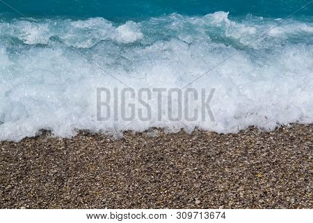 Deep Blue Stormy Sea Water Surface With Foam And Waves Pattern, Natural Background Photo