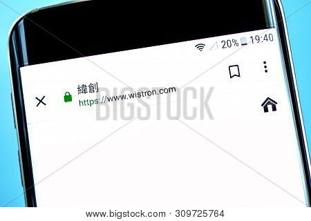 Berdyansk, Ukraine - 14 June 2019: Wistron Website Homepage. Wistron Logo Visible On The Phone Scree