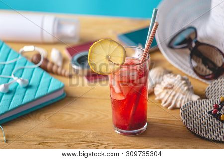 Glass Of Red Lemonade Drink With Lemon And Straw On The Table. Concept Of A Bright Summer Sunny Holi
