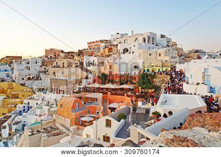 Santorini Greece, June 29 2019: Landscape Of Oia Village Santorini Greece - Tourists Walking Through