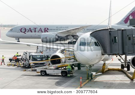 Hamad International Airport, Doha, 2018-05-01: Two Qatar Airline Airplanes At The Airport. Jetway At