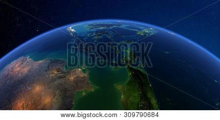 Planet Earth With Detailed Exaggerated Relief At Night Lit By The Lights Of Cities. Southeast Asia.