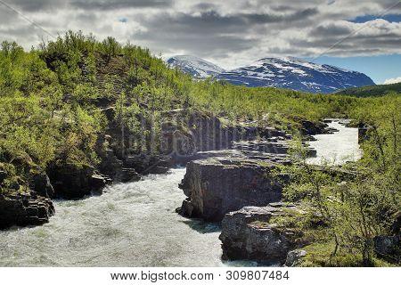Hdr Shot Of The Stream Abiskojakka In Abisko, Norrbotten, Sweden