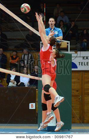 KAPOSVAR, HUNGARY - FEBRUARY 3: Kamilla Gyorbiro (red 6) in action at the Hungarian Championship volleyball game Kaposvar (red) vs Miskolc (green), February 3, 2012 in Kaposvar, Hungary