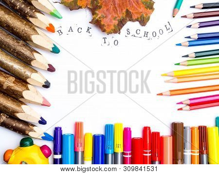 Back To School, Education Concept. A Range Of Consumables, Colored Markers, Pencils And Autumn Leave