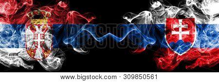 Serbia Vs Slovakia, Slovakian Smoky Mystic Flags Placed Side By Side. Thick Colored Silky Smokes Com