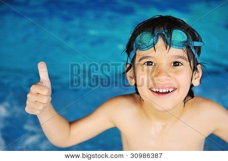 Little boy at swimming pool
