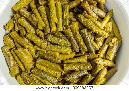 Top View Of Traditional Turkish Meal, Vine Leaves Stuffed With Seasoned Rice, Dolma.