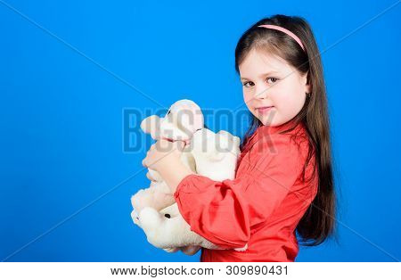 Cherishing memories of childhood. Childhood concept. Small girl smiling face with toys. Happy childhood. Little girl play with soft toy teddy bear. Lot of toys in her hands. Collecting toys hobby poster