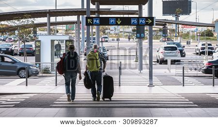 Outgoing Passengers With Their Suitcase At The Car Park Of Faro International Airport
