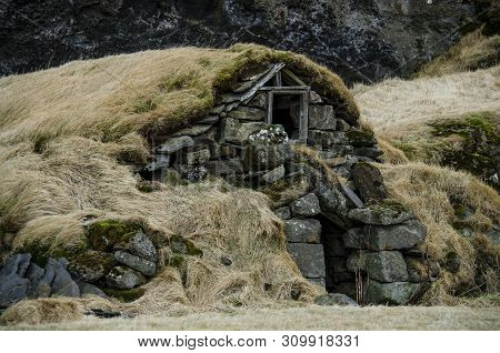 Old Stone House Destroyed Ancient Viking Overgrown With Yellow Dry Grass In Iceland