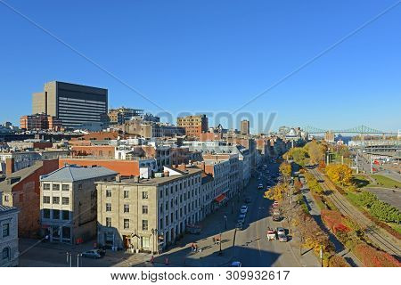 Montreal, Canada - Nov 2, 2012: Aerial View Of Old Port And Jacques Cartier Bridge On St Lawrence Ri