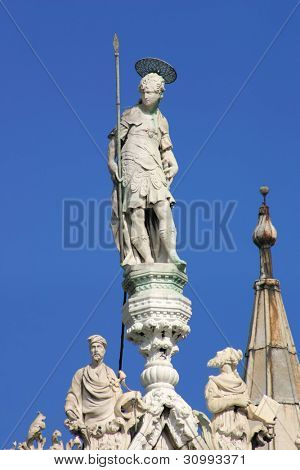 Sculptures on the rooftop of San Marco Basilica against blue sky in Venice, Italy.