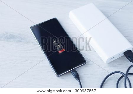 The Phone Is Charging With Power Bank