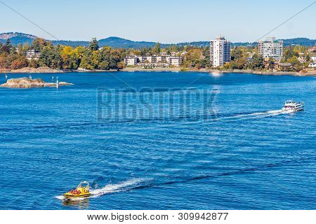 Victoria, Canada - October 02 2017: Tour Boat And Yacht With People/passengers Sailing The Waterfron