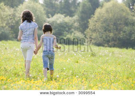 Girls Walking In Field2814