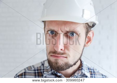 Angry Or Serious Engineer In White Helmet