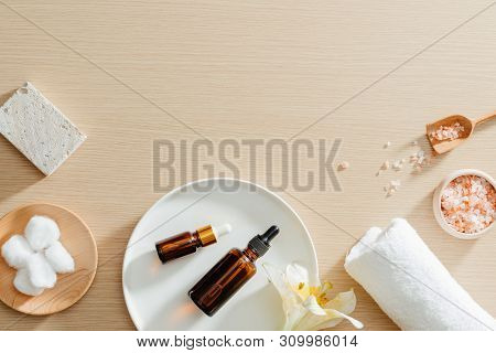 Spa Still Life Top View With Flowers, Natural Oil, Bath Salth And Towels, Spa Skincare Products,pumi