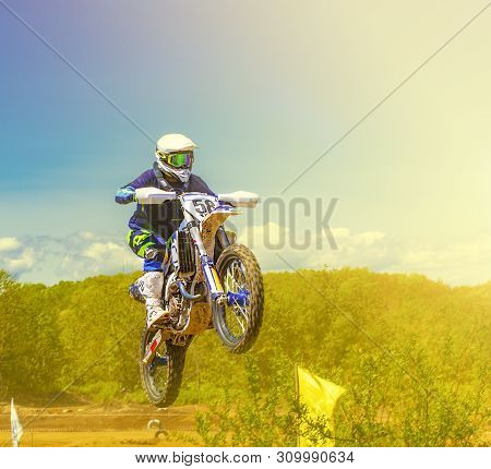 Motocross Riders Practice Tricks On Their Dirt Bikes On A Sunny Day In Kamchatka