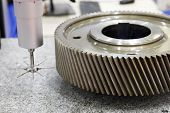 Gear wheel measuring using coordinate measuring machine with touch trigger probe. Selective focus. poster