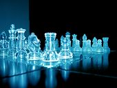 close up shot of glass chess pieces over black background poster