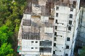 old abandoned rustic incomplete construction building condo poster
